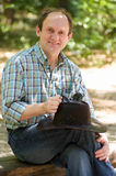 Smiling man with with cowboy hat. Handsome smiling man with with cowboy hat  in the forest Royalty Free Stock Photography