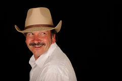 Smiling man in cowboy hat Stock Images