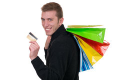 Smiling man with credit card and shopping bags Stock Image