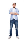 Smiling man with crossed arms Stock Images