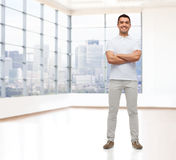 Smiling man with crossed arms Royalty Free Stock Photo