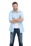 Smiling man crossing arms Stock Image