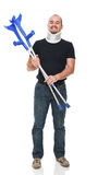 Smiling man with crutch Royalty Free Stock Photos