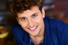 Smiling man with curly hair Stock Images