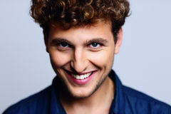 Smiling man with curly hair Royalty Free Stock Images