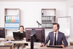 Smiling man from Customer service support working in the office Stock Images
