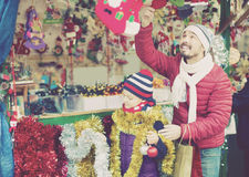 Smiling man with daughter buying decorations Royalty Free Stock Photos