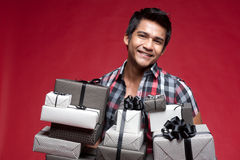 Smiling Man with different boxes of presents Royalty Free Stock Photo