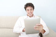 Smiling  man  with digital tablet Royalty Free Stock Image