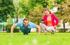 Smiling man doing exercise outdoors Royalty Free Stock Images