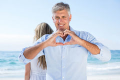 Smiling man doing heart shape with his hands Royalty Free Stock Images