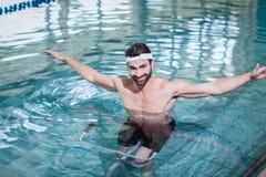 Smiling man doing underwater bike Royalty Free Stock Photos