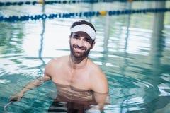 Smiling man doing underwater bike Stock Photos