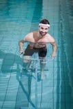 Smiling man doing underwater bike Royalty Free Stock Images