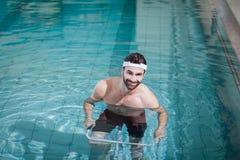 Smiling man doing underwater bike Stock Photography