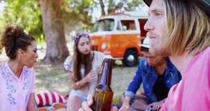 Man drinking beer with his friends at music festival 4k. Smiling man drinking beer with his friends at music festival 4k stock footage