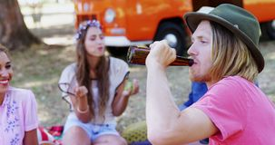 Man drinking beer with his friends at music festival 4k. Smiling man drinking beer with his friends at music festival 4k stock video footage