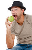 Smiling man eating an green apple Stock Photo