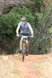 Smiling man enjoying outdoors ride at Mountain Bike Race Stock Photos