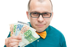 Smiling man with european money Stock Photos