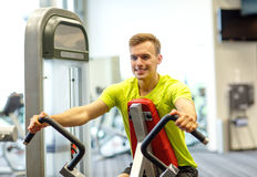 Smiling man exercising in gym Royalty Free Stock Image
