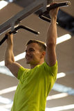 Smiling man exercising in gym Stock Images