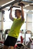 Smiling man exercising in gym Stock Image