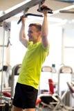 Smiling man exercising in gym Royalty Free Stock Image
