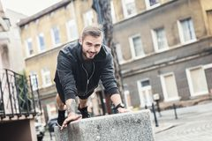 Smiling man exercising outside. Royalty Free Stock Images