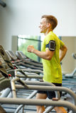 Smiling man exercising on treadmill in gym Stock Photography