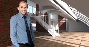 Smiling man in an expensive loft stock photos