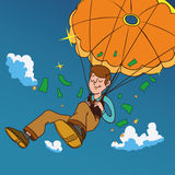 Smiling man fall on a golden parachute. Stock Images