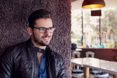 Smiling man with fashionable haircut and eyeglasses Royalty Free Stock Image