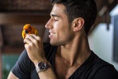 Smiling man feeding parrot Royalty Free Stock Photo