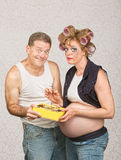 Smiling Man Feeding Pregnant Woman Stock Photo