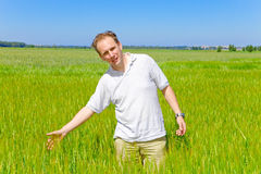 The smiling man in  the field Royalty Free Stock Photo