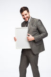 Smiling man with framed board Stock Image