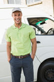 Smiling man in front of delivery van Royalty Free Stock Photo