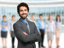 Smiling man in front of a group of people Stock Photography