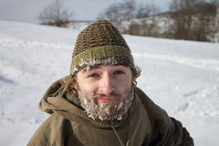 A smiling man with frozen beard Stock Photo