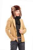 A smiling man with fur hat posing Royalty Free Stock Photo