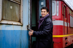 Smiling man getting on train Royalty Free Stock Image