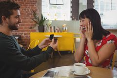 Smiling man gifting ring to girlfriend Royalty Free Stock Photography