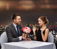 Smiling Man Giving Flower Bouquet To Woman Stock Images