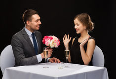 Smiling man giving flower bouquet to woman Royalty Free Stock Photos