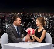 Smiling man giving flower bouquet to woman Royalty Free Stock Image
