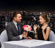 Smiling man giving flower bouquet to woman Royalty Free Stock Photo