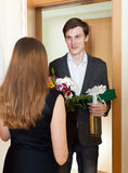 Smiling man giving gifts to woman Royalty Free Stock Image