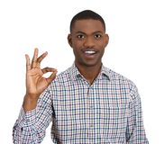 Smiling man giving OK sign Royalty Free Stock Images