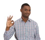 Smiling man giving OK sign Stock Image